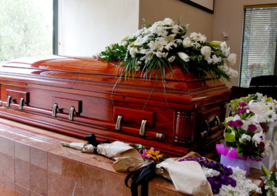 closeup shot of a colorful casket in a hearse or chapel before f